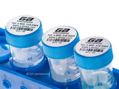 Three 50 ml tubes in a rack, with their caps labeled with circle cryogenic laser labels, printed with alphanumeric text and a 1D barcode.