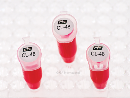 Three microtubes in a rack, with their caps labeled with Cryo-LaztTAG circle cryogenic laser labels, printed with alphanumeric text.