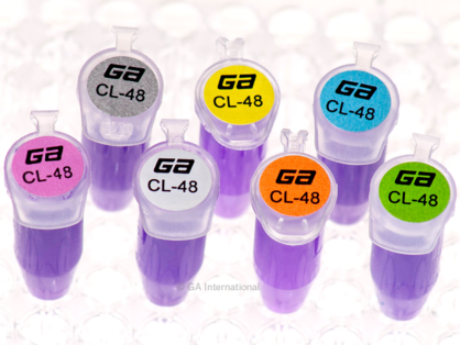 Microtubes filled with purple liquid placed on a holder, and labeled with multi-color permanent cryogenic laser dot labels.