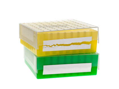 A green cryo box labeled with cryogenic destructible tape, with an open yellow cryo box, where the destructible label has been visibly torn, on top of it.