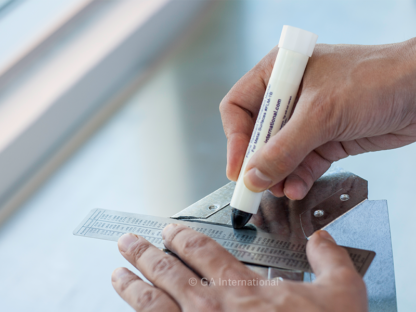 A worker marking a metal surface with the Flame-Marker, flame resistant permanent ink marker.