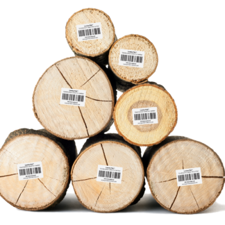 Stacked pieces of lumber labeled with durable LumberTAG construction labels by LabTAG.
