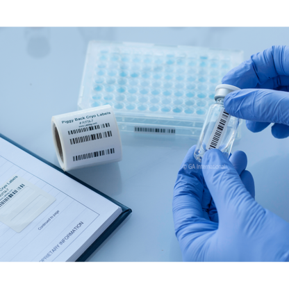 A gloved hand applying a label to a glass vial from a barcode printed cryogenic piggyback thermal-transfer label placed in a lab notebook.