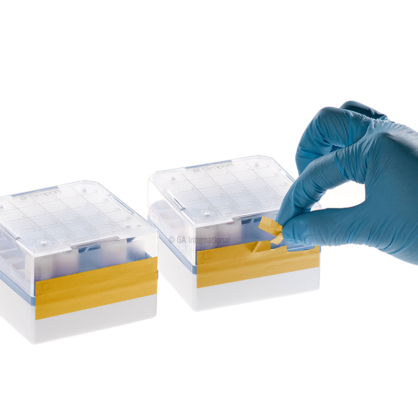 Two cryo boxes labeled with yellow tamper-evident cryogenic tape, with one being torn, from an attempt to remove it.