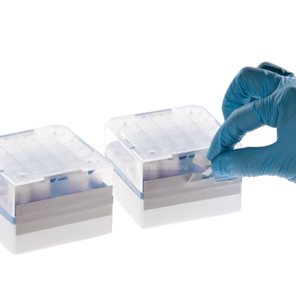 Two cryo boxes labeled with white tamper-evident cryogenic tape, with one being torn, from an attempt to remove it.