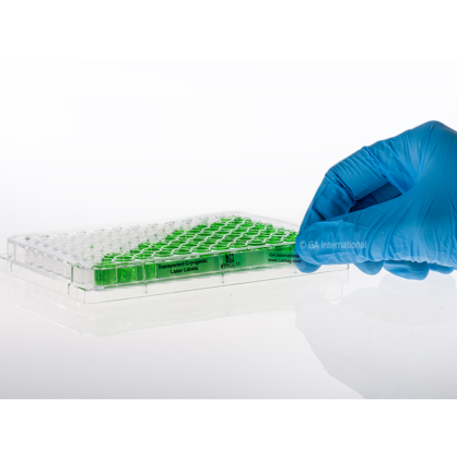 A gloved hand labeling a clear microtiter plate with a transparent cryogenic removable label for laser printers, printed with text and a 2D barcode.