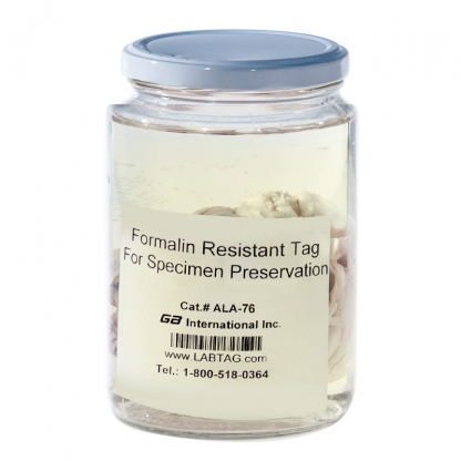 A jar with a sample preserved in formalin, along with a formalin resistant tag, printed with alphanumeric text and a 1D barcode.